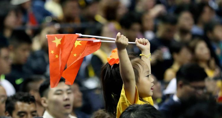 Photo of a child holding Chinese national flags