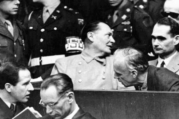 Photo of Nazi German Foreign Minister Joachim von Ribbentrop, right, leans in front of Rudolf Hess, Hitler's deputy