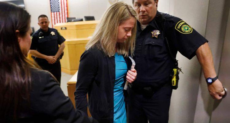Photo of Amber Guyger leaving court for jail