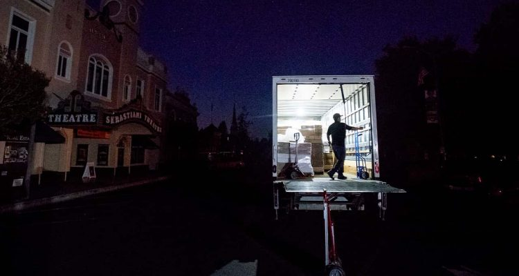 Photo of Armando Espinoza delivering paper products to a cafe in Sonoma, CA