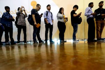 Photo of job seekers lining up at a job fair