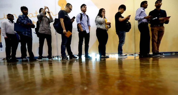 Photo of job seekers lining up at a job fair