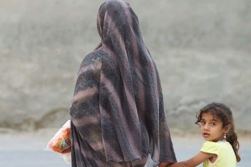 Photo of an Iranian woman and her child