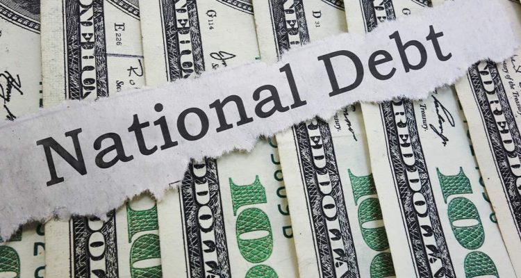 "Photo of money and ""national debt"" on a ripped piece of paper"