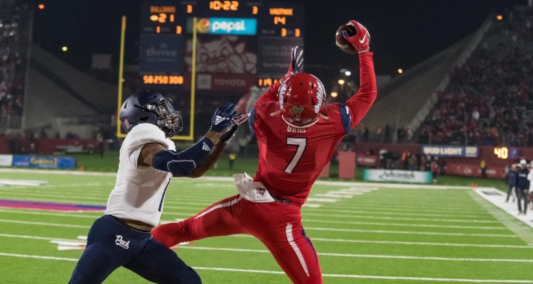 Photo of Derrion Grim catching a touchdown pass