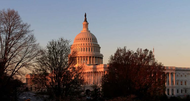 Photo of the Capitol is seen at sunrise in Washington