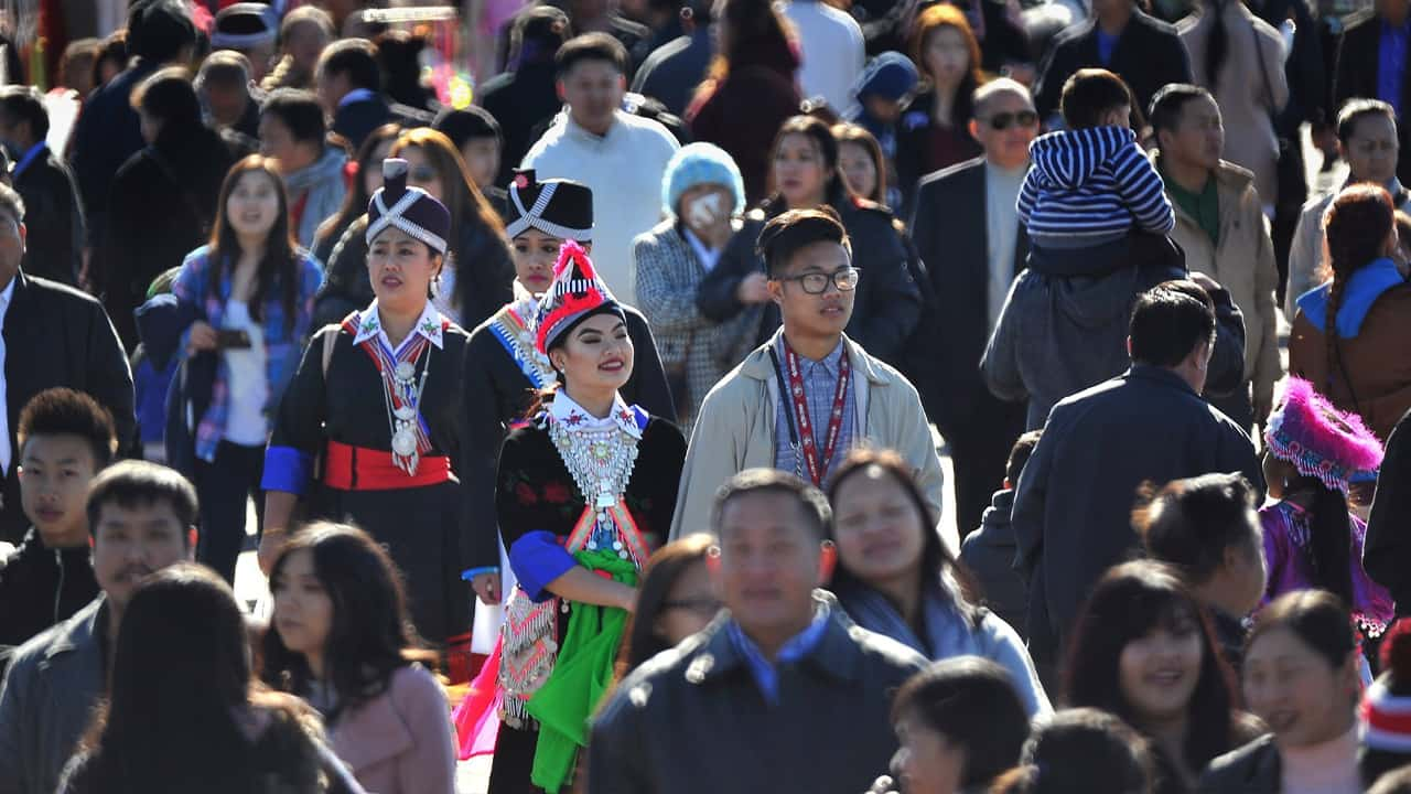In this photo taken Dec. 26, 2016, thousands filled the fairgrounds for the first day of the Hmong International New Year in Fresno, Calif. The country's small Hmong American population is reeling from the shooting deaths of four men at a backyard party at a Northern California central valley city. Fresno hosts a week-long New Year's party every year that draws tens of thousands of Hmong from around the country, complete with colorful traditional dress, song, and sports games. (John Walker/The Fresno Bee via AP)