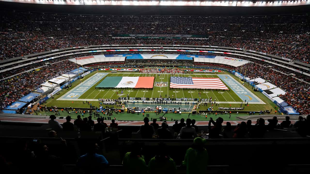 Photo of Mexico and US flag covering the field during an NFL game