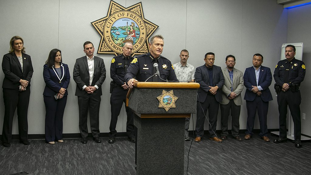 Photo of Fresno Police Chief Andrew Hall speaking at a news conference about a mass shooting
