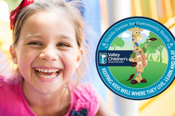 Photo of a smiling girl and logo for Valley Children's new center to promote children's health