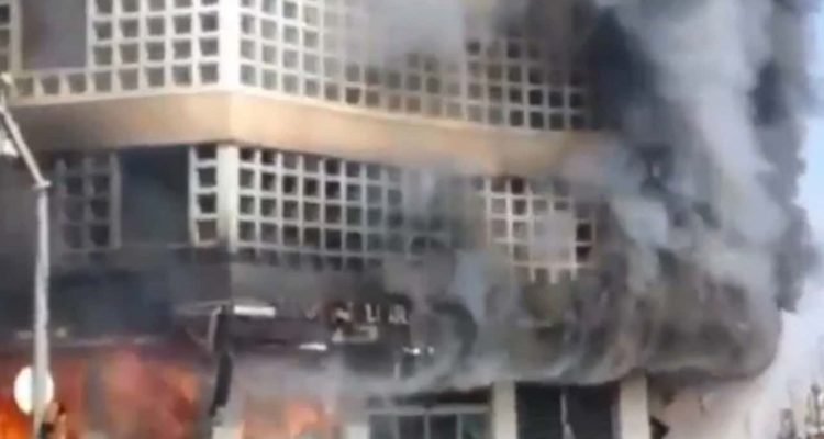 Photo of a bank on fire in Iran