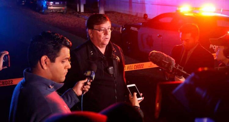 Fresno Deputy Chief Mike Reid talks to reporters