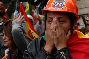 Photo of opponents of Bolivia's Present Evo Morales celebrating after he announced his resignation
