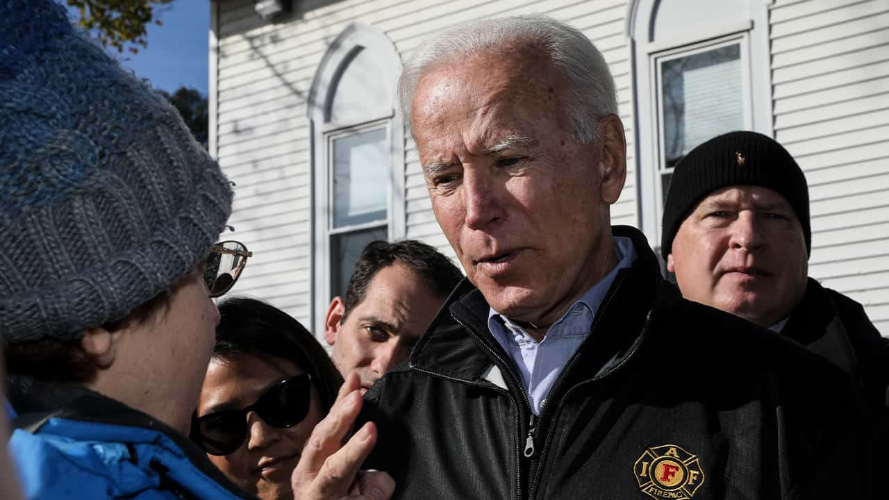 Democratic presidential candidate former Vice President Joe Biden talks with an attendee at a Fire Fighter Chili and Canvass Kickoff in Concord, N.H. Saturday, Nov. 9, 2019. (AP Photo/ Cheryl Senter)