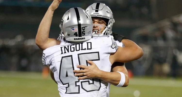 Photo of Derek Carr hugging Alec Ingold