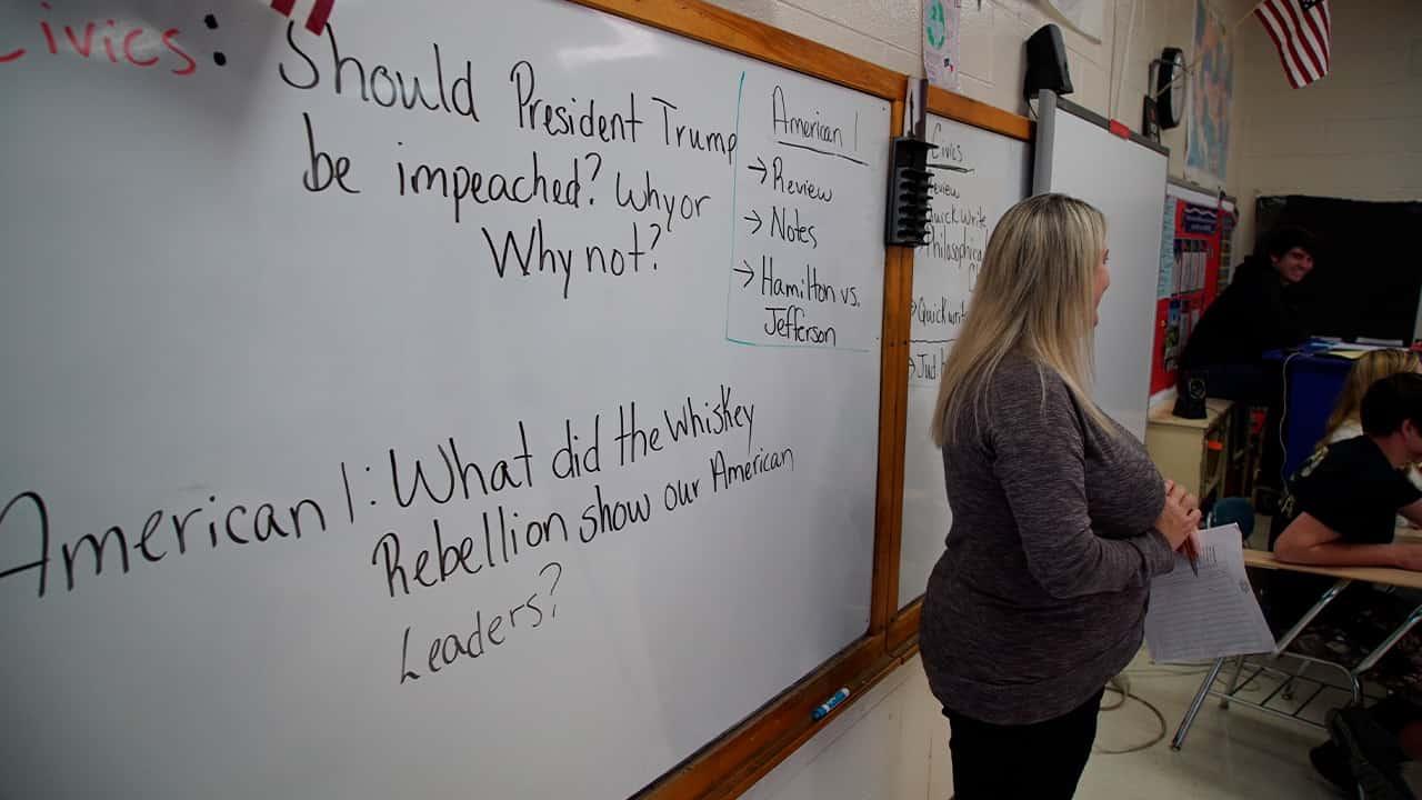 Photo of a civics teacher standing before her class