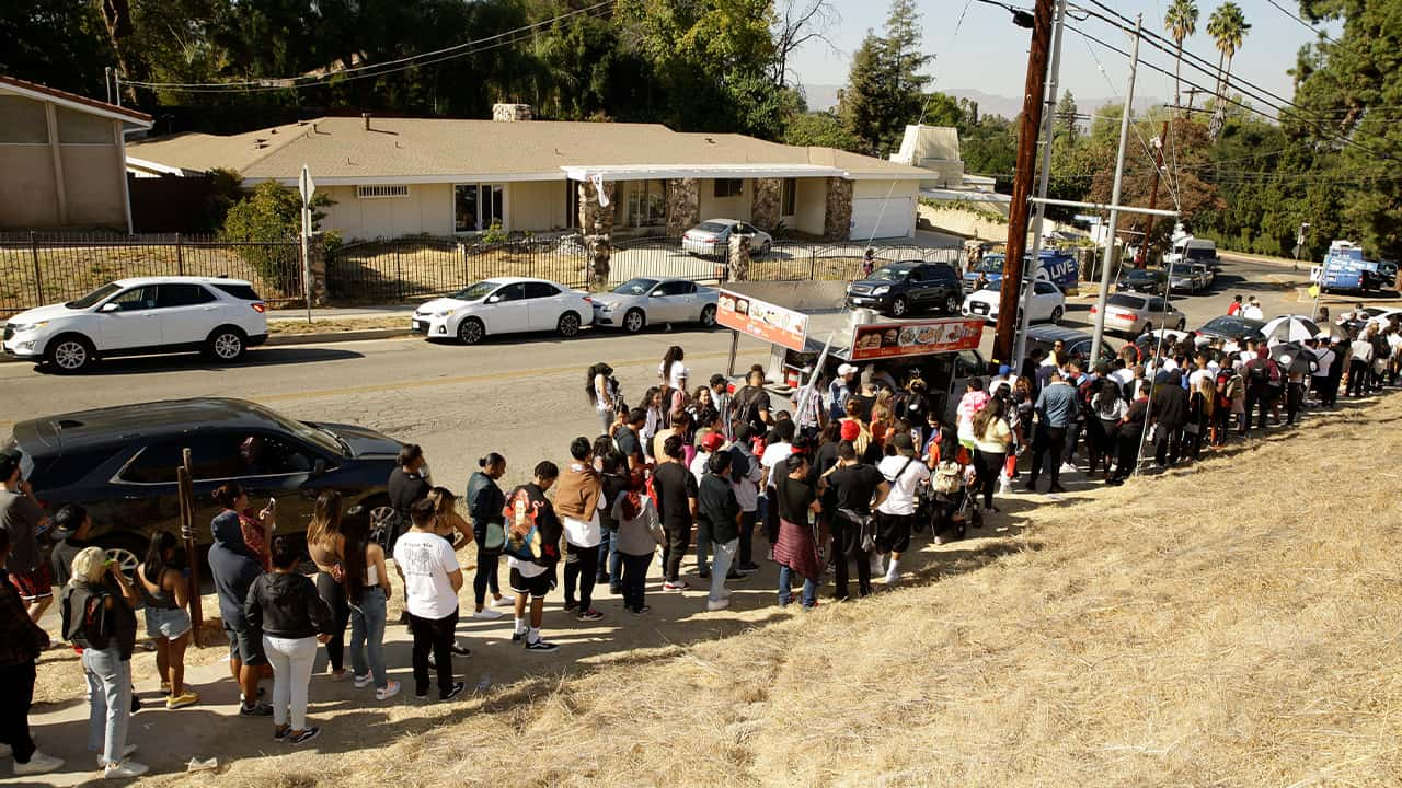Photo of people lining up for Chris Brown's yard sale