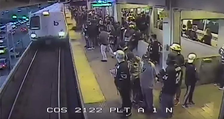 Photo of BART employee saving a man from the train