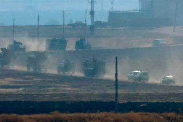 Photo of military vehicles moving in a convoy