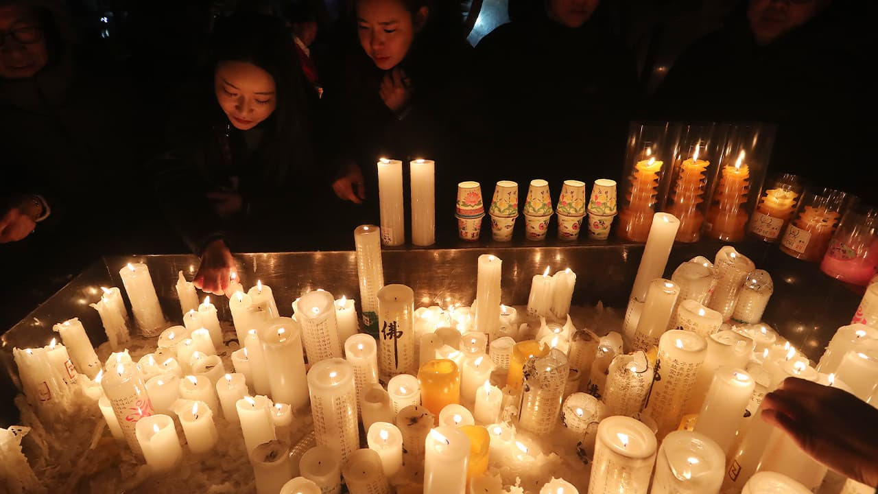 People lighting candles for New Year's in South Korea