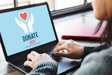 Photo of a woman at a laptop donating online
