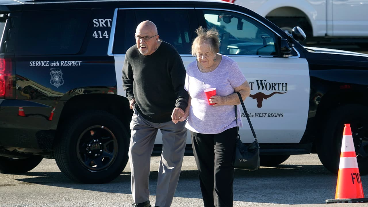 Photo of elderly couple walking from the West Freeway Church of Christ