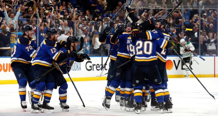 Photo of St. Louis Blues celebrating after defeating the Dallas Stars in double overtime in Game 7 of an NHL second-round hockey playoff series in St. Louis