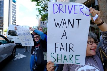 Photo of Uber and Lyft drivers during a demonstration