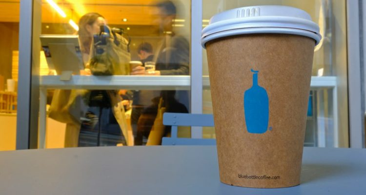 Photo of a Blue Bottle Coffee paper to-go cup
