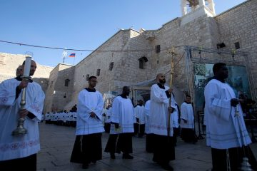 Photo of clergymen participating in Christmas celebrations in West Bank