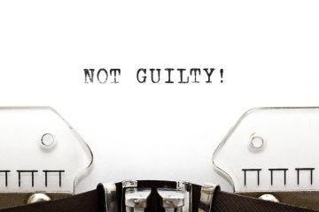 "the words ""Not Guilty!"" on white paper in a typewriter"