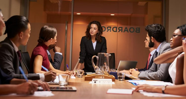 Photo of a women executive leading a board meeting