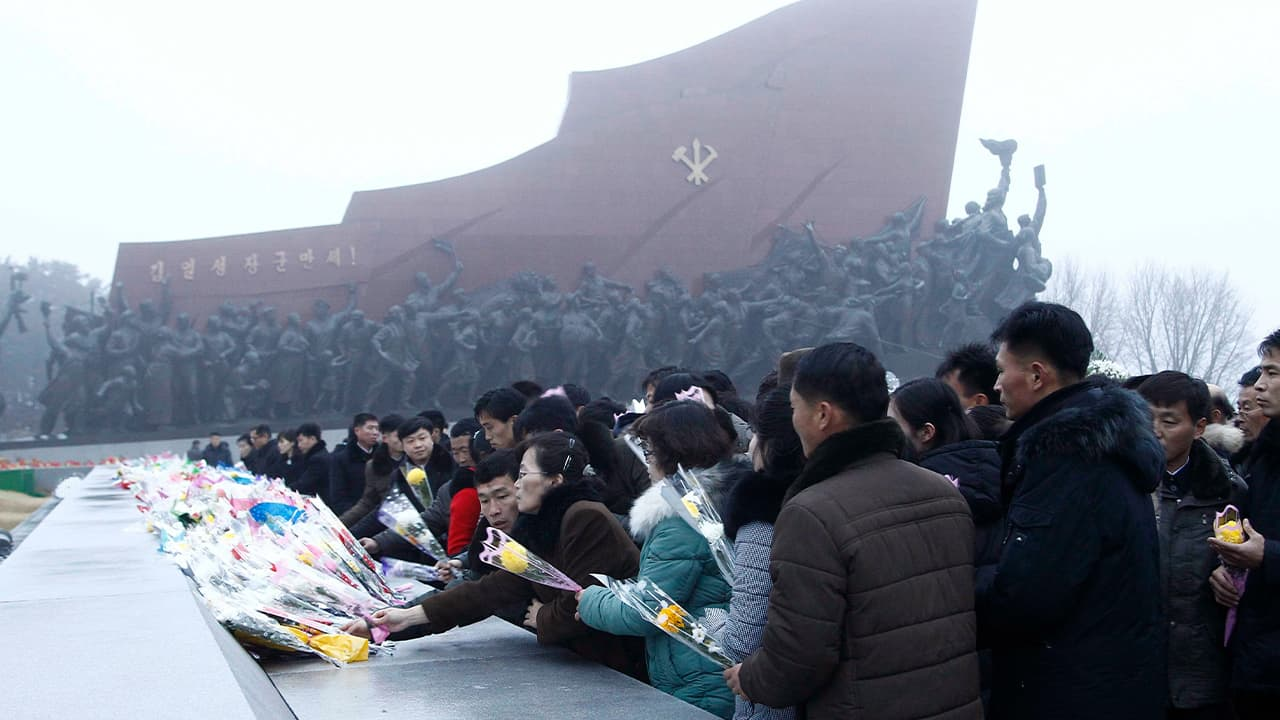 Photo of North Koreans visiting Mansu Hill to lay flowers to the bronze statues of their late leaders Kim Il Sung and Kim Jong Il in Pyongyang