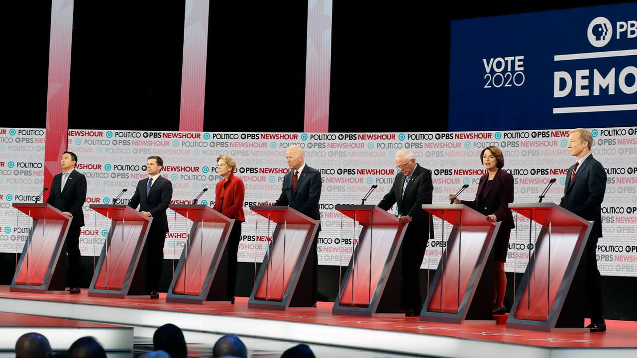 Photo of presidential candidates from left, entrepreneur Andrew Yang, South Bend Mayor Pete Buttigieg, Sen. Elizabeth Warren, D-Mass., former Vice President Joe Biden, Sen. Bernie Sanders, I-Vt., Sen. Amy Klobuchar, D-Minn., and businessman Tom Steyer