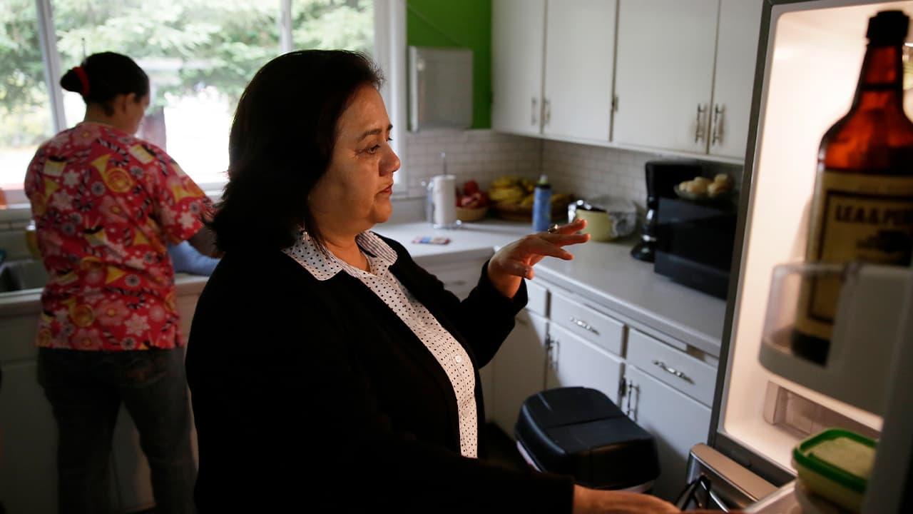 Photo of Irais Lopez-Ortega opening a refrigerator