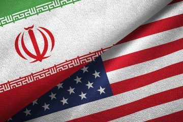 Photo of an Iranian flag and American flag