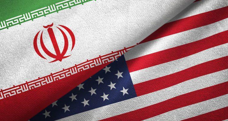 Photo of an Iranian flag and American flag