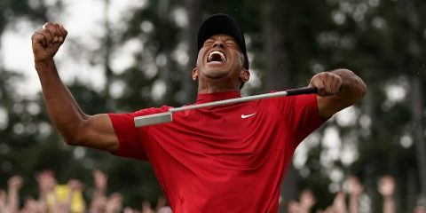 Photo of Tiger Woods celebrating
