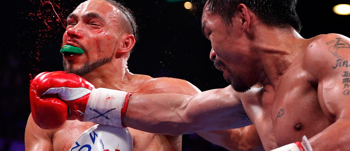 Photo of Manny Pacquiao punching Keith Thurman