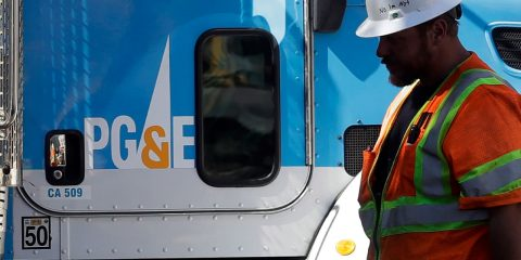 Photo of PG&E worker and truck