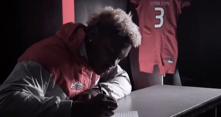 Image from video of Mykal Walker writing a letter to his late father, Michael James Walker