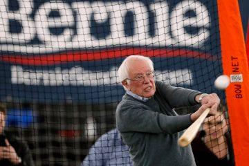 Photo of Sen. Bernie Sanders hitting a baseball