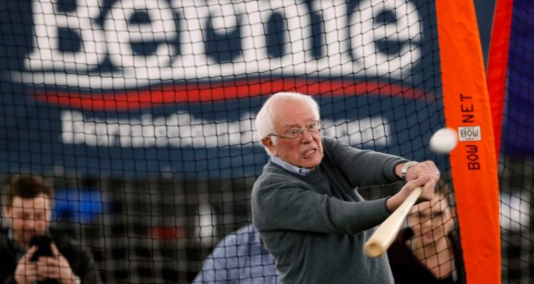 Photo of Sen. Bernie Sanders hitting a baseball