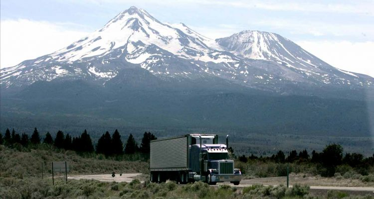 Photo of a big-rig on the road near Mount Shasta