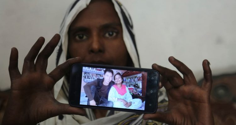 Photo of Pakistani Christian woman Samiya David showing a picture her picture with her Chinese husband