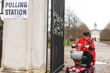 Photo of A Chelsea Pensioner leaving a polling station in London
