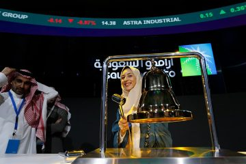 Photo of Sukaynah Al Oqaili ringing the stock bell