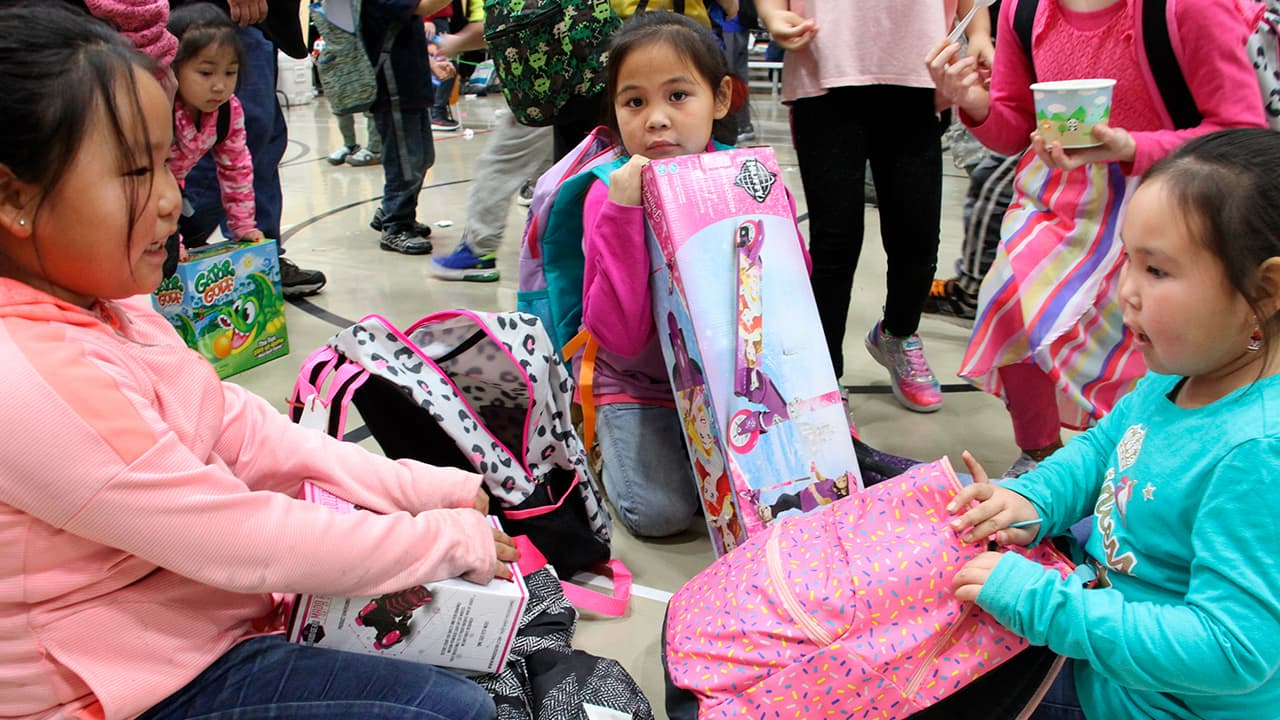 Photo of Krysta Lexie Kau'aq, left, Michelle Nelson, middle and Jessilyn Oscar, right admiring their gifts