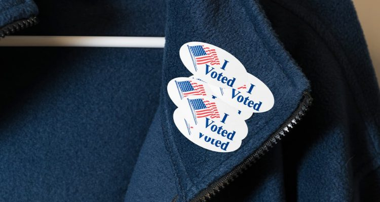 "Photo of a jacket with multiple ""I Voted"" stickers"