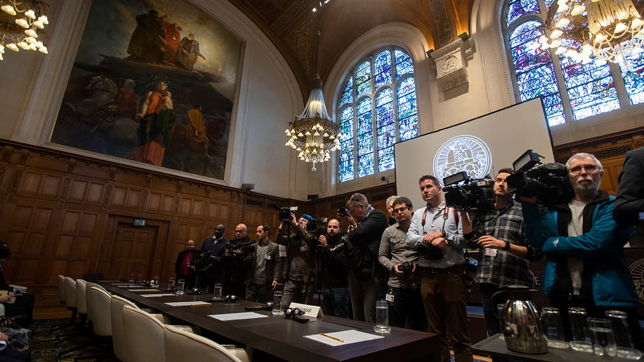Photo of journalists waiting in the court room